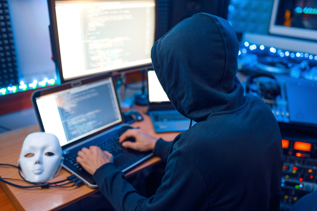Hacker in mask and hood, account hacking